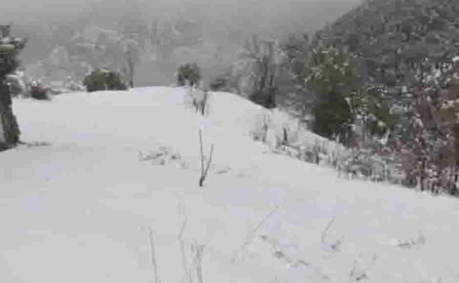 Cold wave grips Rajouri district after Pir Panjal mountain range receives heavy snowfall. ANI