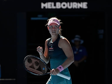 Germany's Angelique Kerber celebrates after defeating Slovenia's Polona Hercog during their first round match at the Australian Open tennis championships in Melbourne, Australia, Monday, Jan.14, 2019. (AP Photo/Aaron Favila)