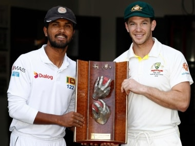 Sri Lanka captain Dinesh Chandimal (L) and Australia skipper Tim Paine pose with the Warne–Muralidaran Trophy. Image: Twitter: @cricketcomau