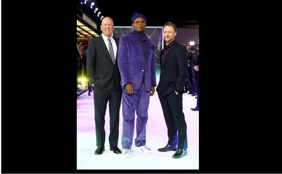 Hollywood star Samuel L Jackson stood out in a bright purple velvet suit as he walked the carpet for the premier.