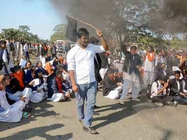 College students block National Highway 37 in protest against the Citizenship (Amendment) Bill, in Dibrugarh on Saturday. PTI
