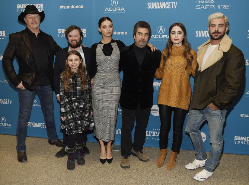 "Joe Berlinger, third from right, director/producer of ""Extremely Wicked, Shockingly Evil and Vile,"" poses with cast members, from left, James Hetfield, Haley Joel Osment, back, Morgan Pyle, front, Angela Sarafyan, Lily Collins and Zac Efron at the premiere of the film during the 2019 Sundance Film Festival, Saturday, Jan. 26, 2019, in Park City, Utah. (Photo by Chris Pizzello/Invision/AP)"