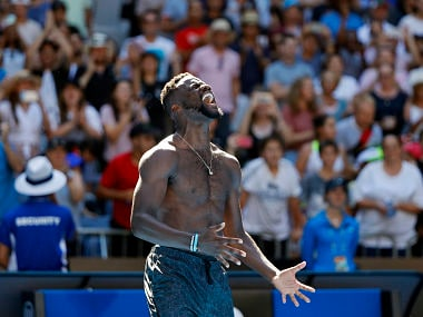 Tennis - Australian Open - Fourth Round - Melbourne Park, Melbourne, Australia, January 20, 2019. Frances Tiafoe of the U.S. celebrates winning the match against Bulgaria's Grigor Dimitrov. REUTERS/Aly Song - UP1EF1K0GV2YA