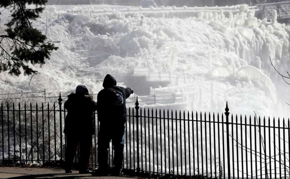 At least four deaths were linked to the weather system by Wednesday. Ice is seen on the side of the Great Falls National Historic Park in Paterson New Jersey. AP