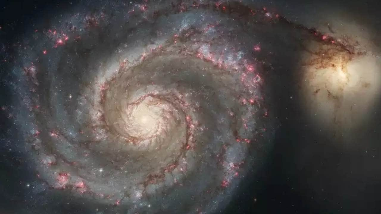 Hubble Space Telescope image representing a merger between two galaxies (M51a and M51b) similar in mass to the Milky Way and the Large Magellanic Cloud. Image credit: NASA/ESA