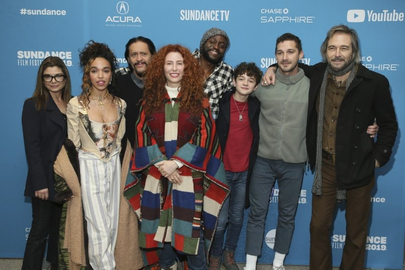 """Director Alma Har'el, fourth from left, poses with actors from left to right, Laura San Giacomo, FKA Twigs, Clifton Collins, Byron Bowers, Noah Jupe, Shia LaBeouf, and Craig Stark at the premiere of """"Honey Boy"""" during the 2019 Sundance Film Festival, Friday, Jan. 25, 2019, in Park City, Utah. (Photo by Danny Moloshok/Invision/AP)"""