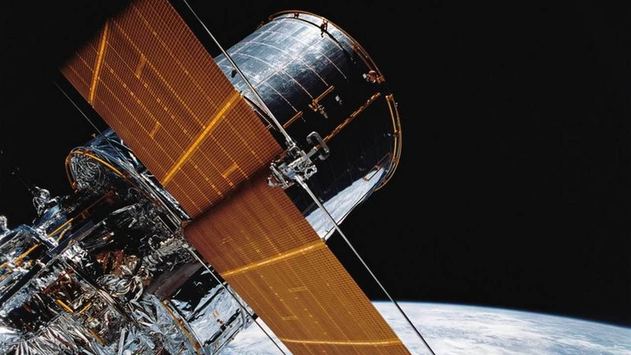 In this April 25, 1990 photograph provided by NASA, most of the giant Hubble Space Telescope can be seen as it is suspended in space by Discovery's Remote Manipulator System (RMS) following the deployment of part of its solar panels and antennae. The Hubble Space Telescope's premier camera has shut down. NASA says the camera suspended operations Tuesday, Jan. 8, 2019, because of a hardware problem. Hubble's three other science instruments are still working fine, with celestial observations continuing. (NASA via AP)
