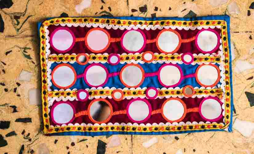 At least one kilogram mirrors cut in several shapes are used in a single Ghagra Choli estimate the community women.