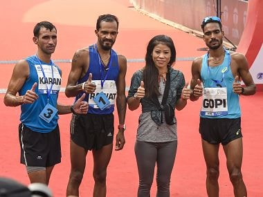 Boxer Mary Kom with Nitendra Singh Rawat (2nd left ) and the other podium finishers at Mumbai Marathon 2019. PTI