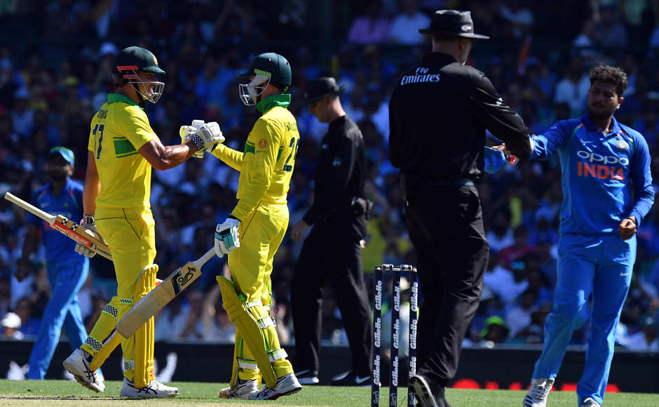 Australia's batsman Peter Handscomb (centre)top-scoredfor thehosts, scoring 73 off 61 balls. Hehit 6 fours and 2 sixes to provide stability to Australian innings.AFP