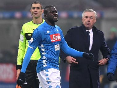 Koulibaly with Napoli coach Carlo Ancelotti after being sent off. Reuters