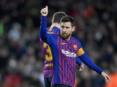 Barcelona's Argentinian forward Lionel Messi celebrates his goal during the Spanish League football match between FC Barcelona and SD Eibar at the Camp Nou stadium in Barcelona on January 13, 2019. - Lionel Messi scored his 400th goal in La Liga against Eibar today to extend his record as the division's all-time top scorer. (Photo by LLUIS GENE / AFP)