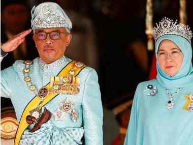 Malaysia's new King Sultan Abdullah Sultan Ahmad Shah and Queen Tunku Azizah Aminah Maimunah outside parliament in Kuala Lumpur. Reuters