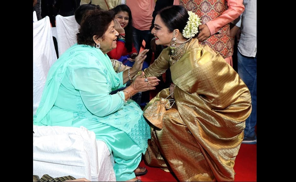 Rekha in a conversation with choreographer Saroj Khan during the event.