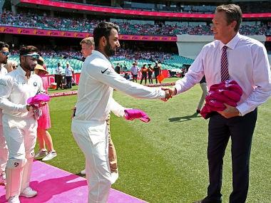 Indian cricketers present Glenn McGrath signed pink caps on Jane McGrath Day at Sydney Cricket Ground