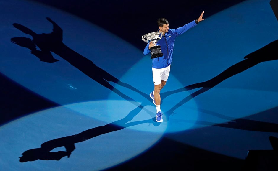 Victory took Novak Djokovic out on his own ahead of Roger Federer and Roy Emerson, who both won six Australian Open men's singles titles. Djokovic has now completed a hat-trick of Slams following his wins at Wimbledon and the US Open. AP Photo