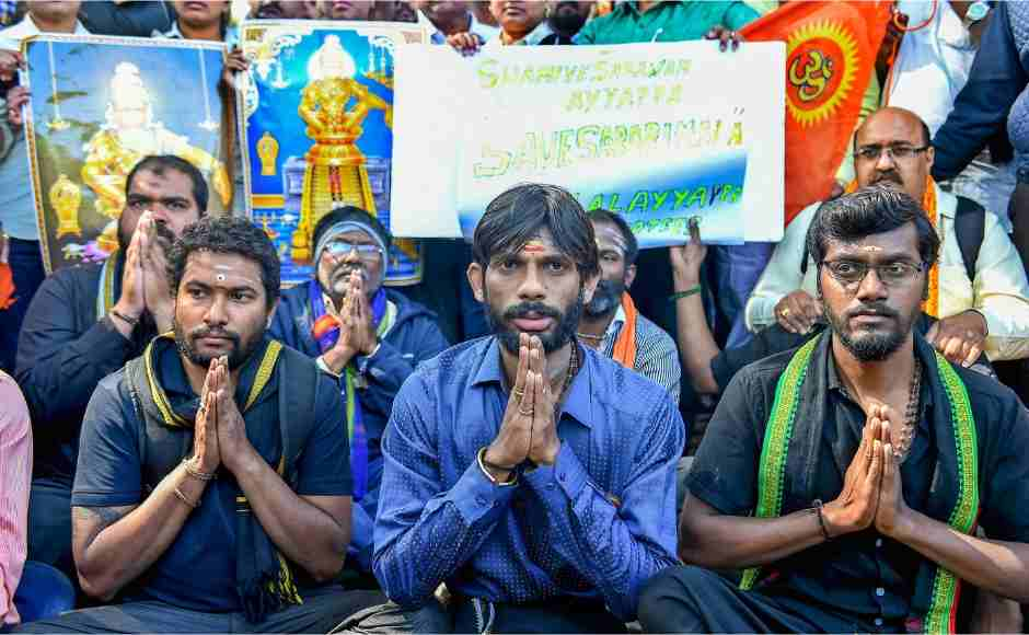 Lord Ayyappa devotees in Bengaluru stage a protest against the entry of two women of menstruating age into the Sabarimala temple on Thursday. PTI