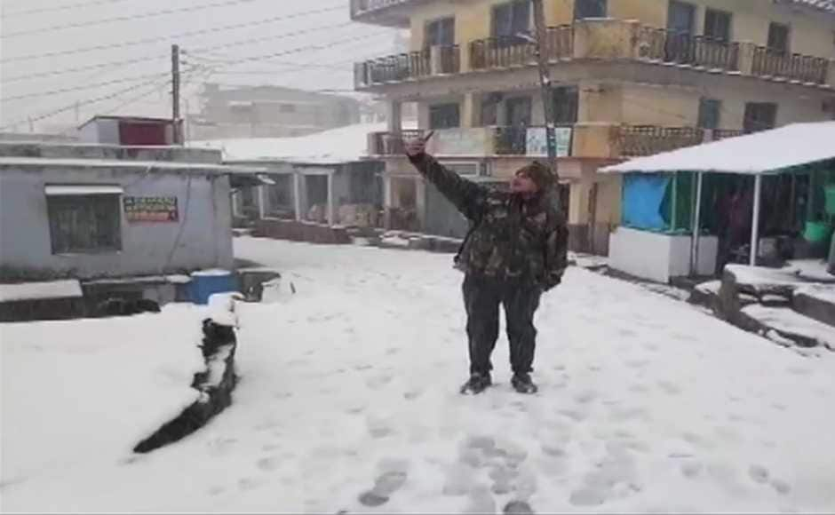 At Ranikhet in Uttarakhand, a fresh layer of snow gave an Armyman an opportunity to click a photograph. ANI