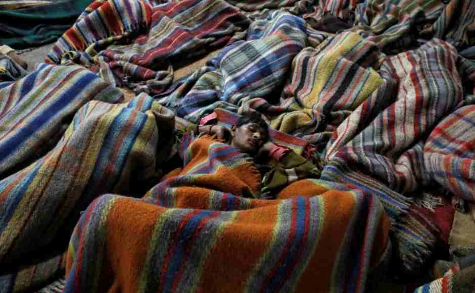 Homeless men sleep inside a government-run night shelter on a cold winter night in the old quarters of Delhi. Reuters/ Anushree Fadnavis