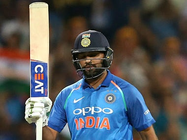 India's Rohit Sharma raises his bat after making 100 runs against Australia during their one day international cricket match in Sydney, Saturday, Jan. 12, 2019. (AP Photo/Rick Rycroft)