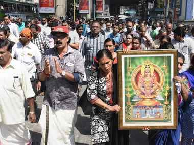 Protestors hold a picture of Lord Ayyappa during a protest called by various Hindu organisations in Kochi on Wednesday. PTI