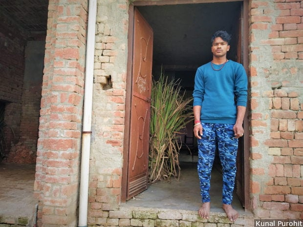 Sumit Kumar at the door of his house in Purbaliyan village in western Uttar Pradesh's Muzaffarnagar district. He is the complainant in two FIRs filed after a fight over a cricket match escalated. Image/Kunal Purohit