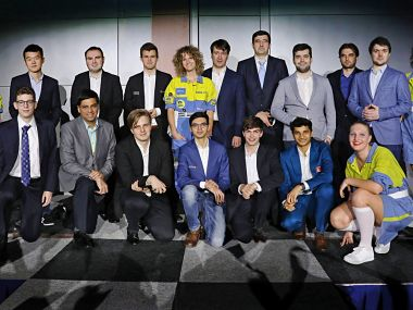 Players from the Masters' and Challengers' segments at the Tata Steel Chess event pose before the start of the event. Image courtesy: Twitter @tatasteelchess