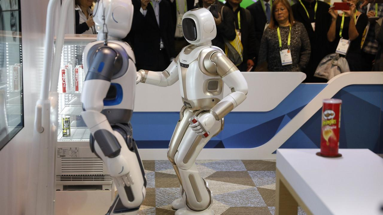 The Walker robot grabs a soda can during a demonstration at the Ubtech booth at CES. Image: AP