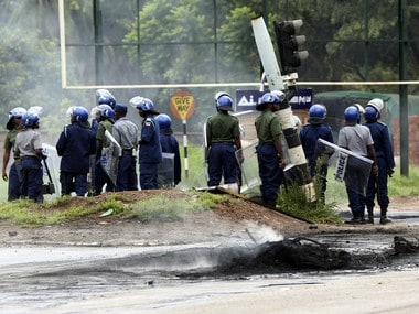 Riot police on the streets during protests over the hike in fuel prices in Harare. AP