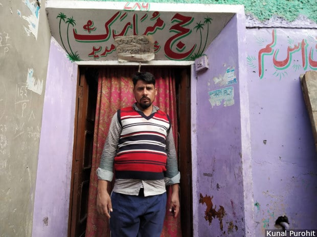 "Haji Aslam outside his house in Moradabad, western UP. He recognised the Hindu men who set his mini-van afire, but police said they would file an FIR only against ""unknown"" persons. Image/Kunal Purohit"