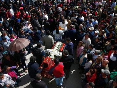 People hold a funeral for a person who died when a gas pipeline exploded in the village of Tlahuelilpan, Mexico, on Sunday. AP