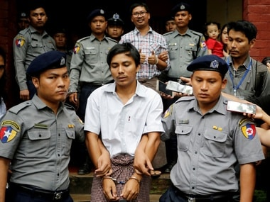 Detained Reuters journalist Kyaw Soe Oo and Wa Lone are escorted by police as they leave after a court hearing in Yangon. Reuters