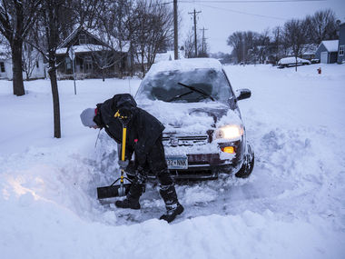 US storm dumps snow and rain on East Coast and Midwest states, snarls travel, closes schools across country