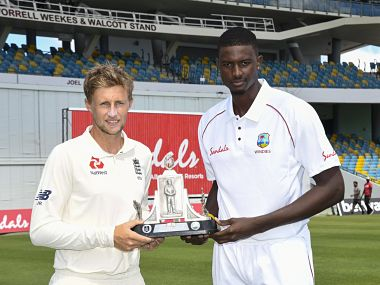 West Indies skipper Jason Holder and England captain Joe Root pose with Wisden trophy on the eve of first Test. Twitter/@windiescricket