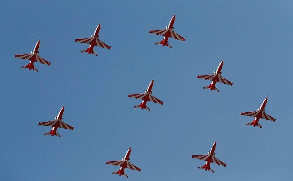 Aero India show's 12th edition commenced on Wednesday at Bengaluru's Yelahanka Air Force base. On the first day of the five-day show, the beginning was a sombre one as a two-minute silence was observed to pay homage to Wing Commander Sahil Gandhi, who lost his life when two Surya Kiran aircraft collided mid-air during rehearsal on Tuesday. The Surya Kiran aerobatics team, comprising of nine aircraft, did not participate in the show. AP