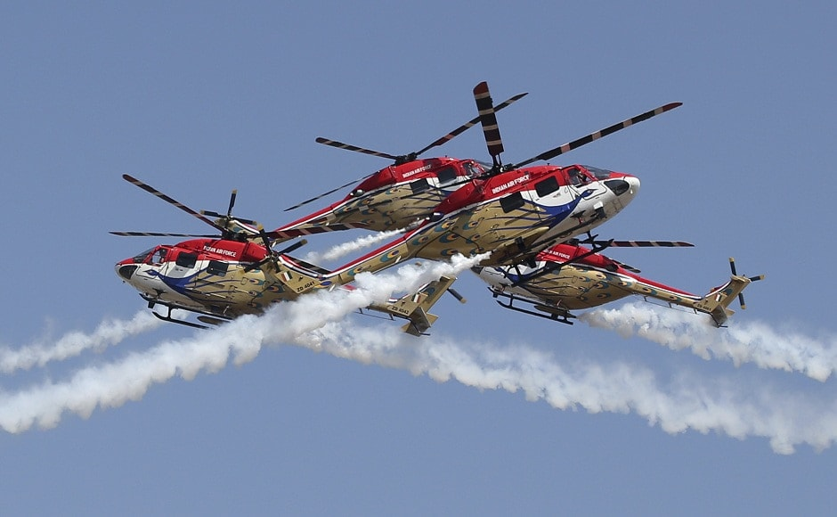 IAF's helicopter aerobatic team Sarang put up a delightful performance for the thousands of people in the crowds, ending the display with a split manoeuvre. AP