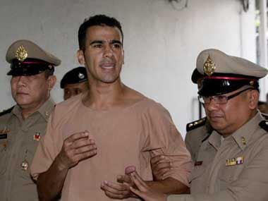 Detained Bahraini soccer player Hakeem al-Araibi arrives at the criminal court in Bangkok, Thailand. AP