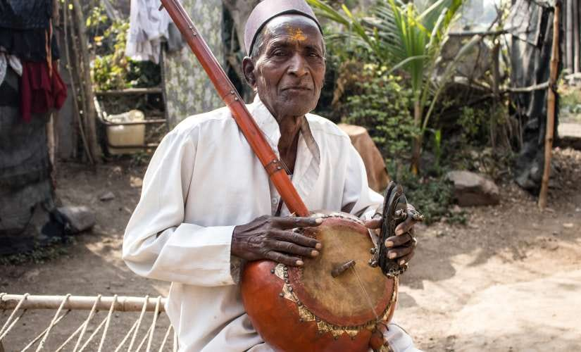 Dhodiram playing the Ektari and Chipli he crafted