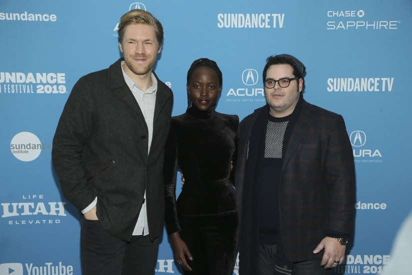 """Alexander England, from left, Lupita Nyong'o and Josh Gad pose at the premiere of the film """"Little Monsters"""" during the 2019 Sundance Film Festival, Tuesday, Jan. 29, 2019, in Park City, Utah. (Photo by Danny Moloshok/Invision/AP)"""