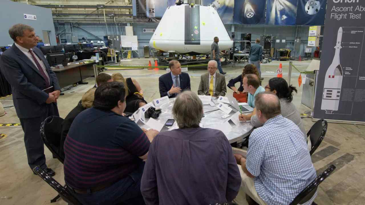 Jim Bridenstine (left, facing camera), and NASA Johnson Space Center Director Mark Geyer (right, facing camera), participate in a media roundtable in front of the Orion test crew capsule at NASA's Johnson Space Center in Houston. Image credit: NASA