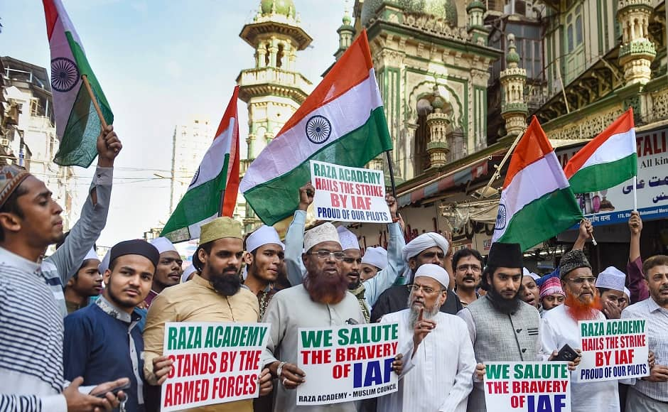 Members of Mumbai's Raza Academy gathered to celebrate the mission's success. They stood waving tricolours and holding placards with messages like 'We salute the bravery of IAF'. PTI