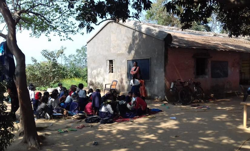 Students studying at a school in Kurji which lacks even the most basic facilities.