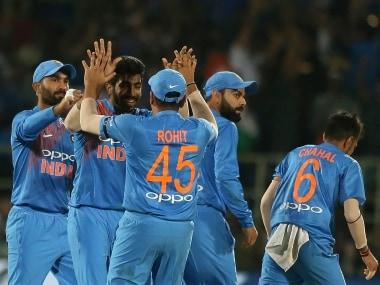 India's bowler Jasprit Bumrah celebrates with Rohit Sharma the wicket of Australia's Peter Handscomb during the first Twenty20 international cricket match between India and Australia, in Visakhapatnam, India, Sunday, Feb. 24, 2019. (AP Photo/Mahesh Kumar A.)