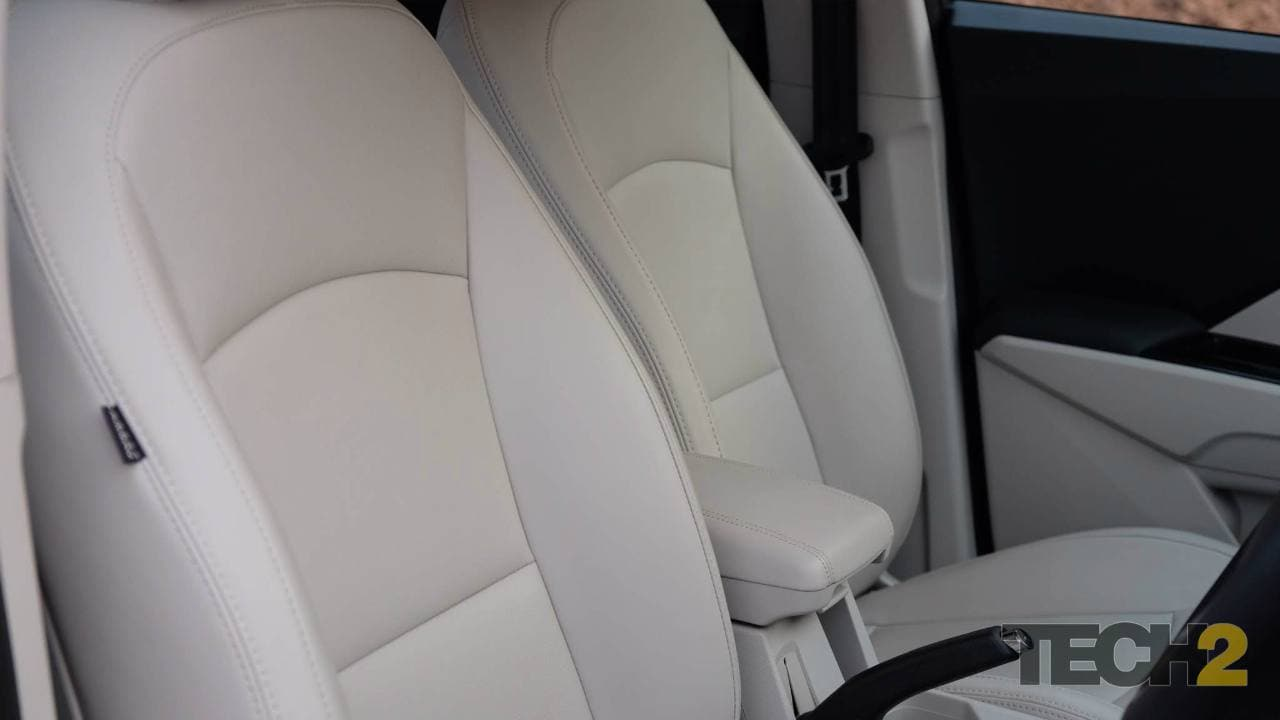 The centre console on the XUV wears a touchscreen infotainment system flanked by AC vents and controls for a dual-zone climate control system.
