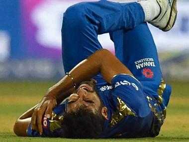 Mumbai Indians' Jasprit Bumrah clutches his shoulder in pain after a tumble. AFP