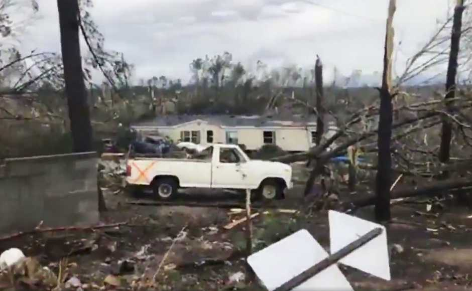 The tornado travelled through a county road into the rural community of Beauregard, destroying homes on its half a mile wide path. AP