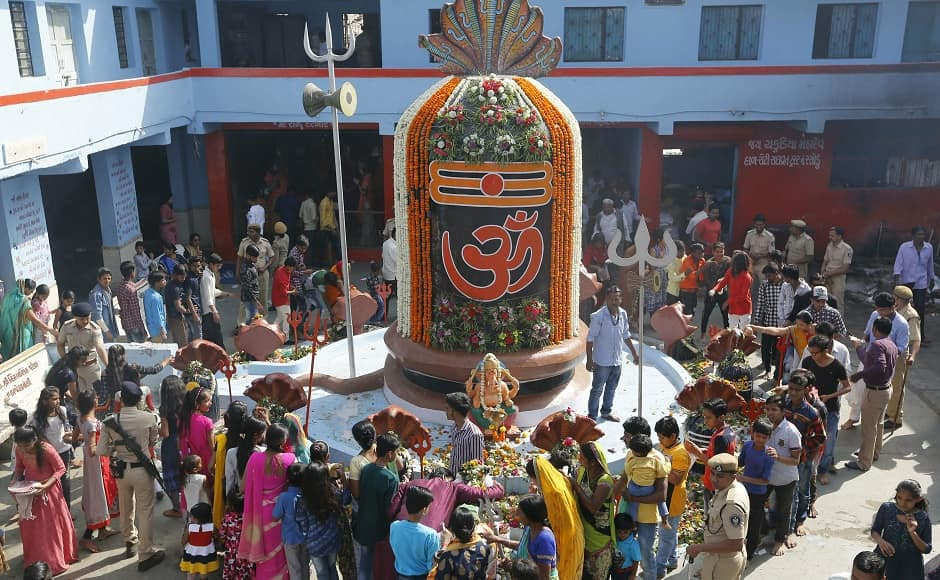 Lakhs of devotees celebrated Mahashivratri across the country on Monday, observing fasts, offering fruits and milk to shivalingas in temples and conducting the tradition of whispering into the ear of the Nandi bull. Seen here are the festivities in Ahmedabad. AP