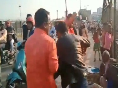 A screenshot from the video shared by Twitter user Prashant Kumar, showing the men beating up a Kashmiri man in Lucknow.