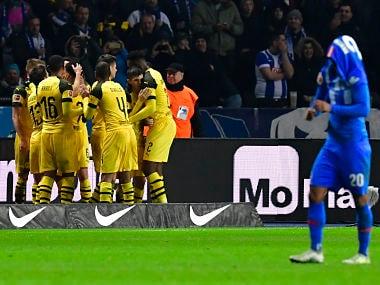 Bundesliga: Marco Reus sends Borussia Dortmund atop standings with late winner against Hertha Berlin; Schalke lose again