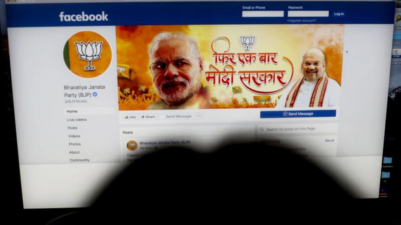 A woman checks the Facebook page of India's ruling Bharatiya Janata Party. Image: AP